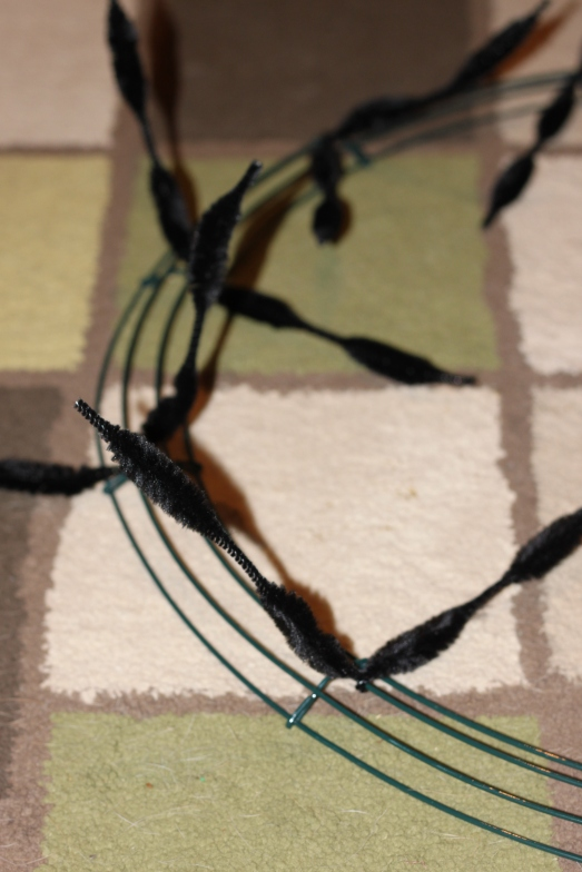 Twist pipe cleaners around the wire frame at regular intervals.