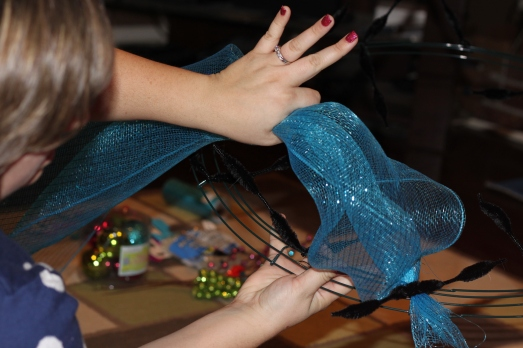 Gather the mesh after about 6 inches to create a pouf and secure to the next pipe cleaner.  Repeat all the way around!